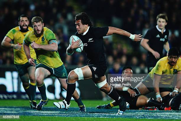 Steven Luatua of the All Blacks runs in to score a try during The Rugby Championship match between the New Zealand All Blacks and the Australian...