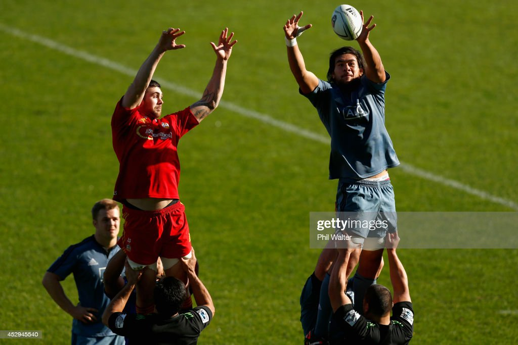 Steven Luatua of the All Blacks (R) takes the ball in the lineout during a New Zealand All Blacks training session at North Harbour Stadium on July 31, 2014 in Auckland, New Zealand.