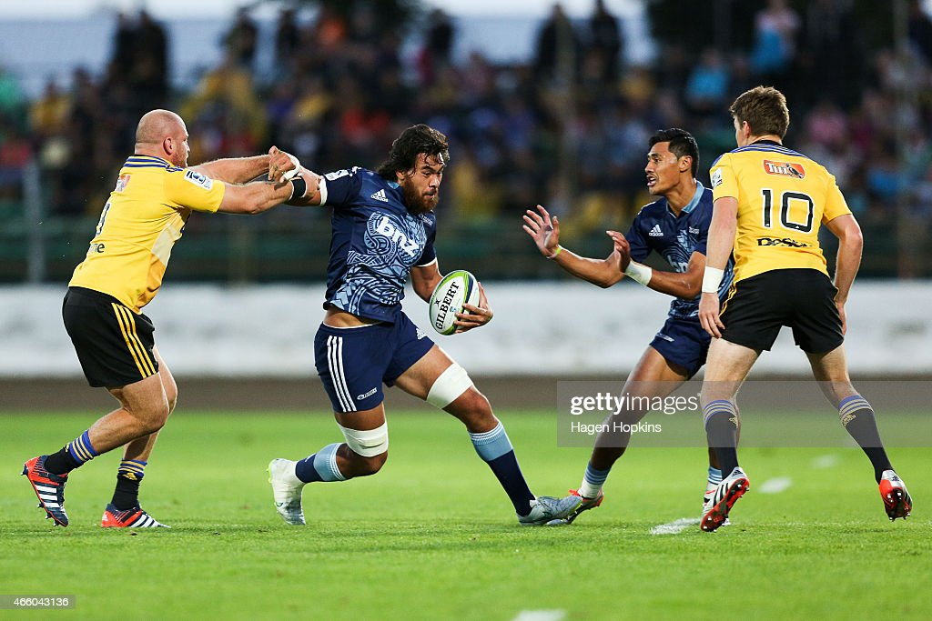 Steven Luatua of the Blues fends Ben Franks of the Hurricanes during the round five Super Rugby match between the Hurricanes and the Blues at Arena...