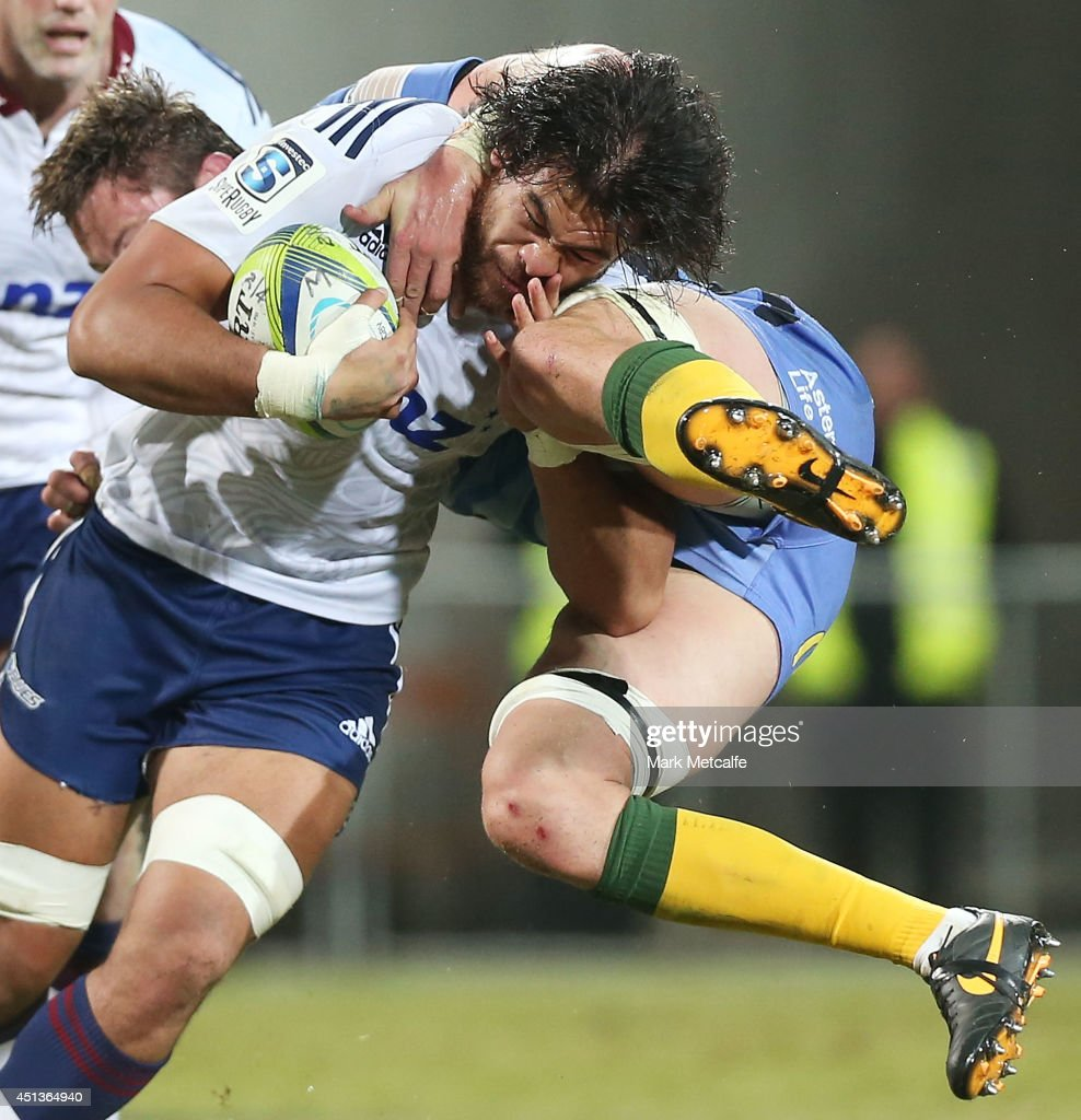 Steven Luatua of the Blues is tackled by Hugh McMeniman of the Force during the round 17 Super Rugby match between the Force and the Blues at nib...