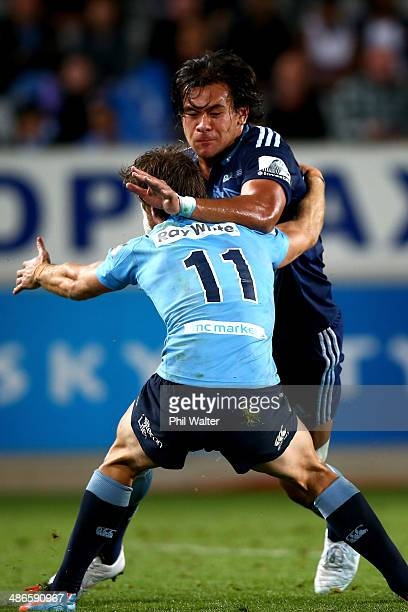 Steven Luatua of the Blues is tackled by Rob Horne of the Waratahs during the round 11 Super Rugby match between the Blues and the Waratahs at Eden...