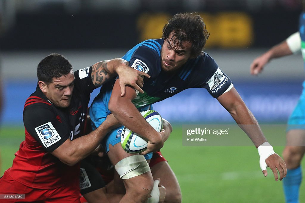 <a gi-track='captionPersonalityLinkClicked' href=/galleries/search?phrase=Steven+Luatua&family=editorial&specificpeople=6164979 ng-click='$event.stopPropagation()'>Steven Luatua</a> of the Blues is tackled during the round 14 Super Rugby match between the Blues and the Crusaders at Eden Park on May 28, 2016 in Auckland, New Zealand.