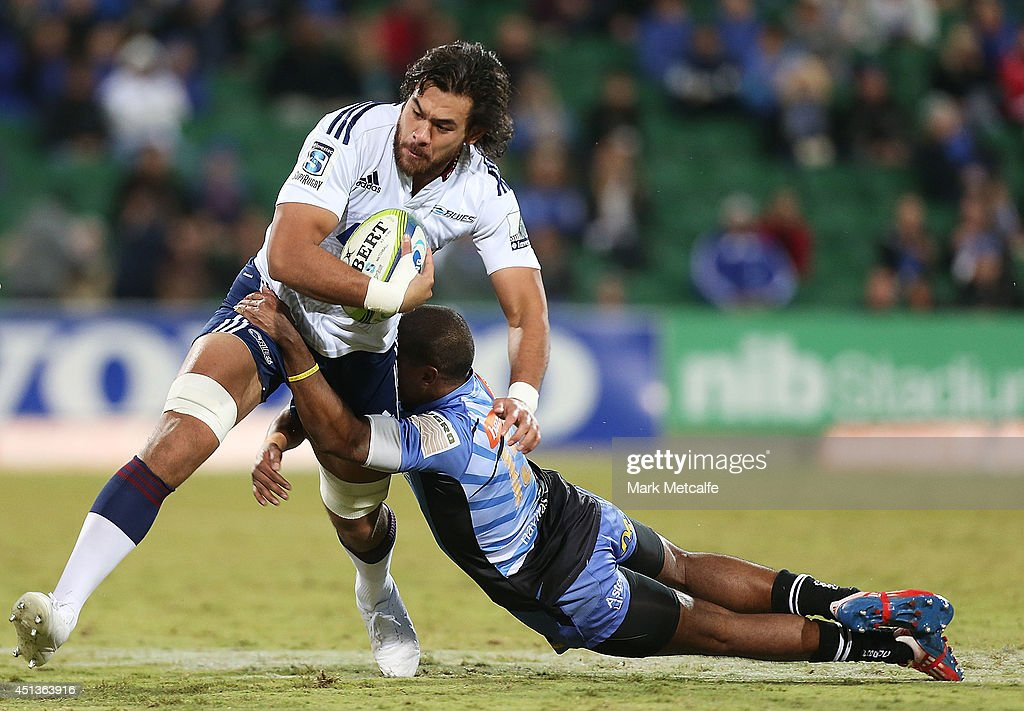 <a gi-track='captionPersonalityLinkClicked' href=/galleries/search?phrase=Steven+Luatua&family=editorial&specificpeople=6164979 ng-click='$event.stopPropagation()'>Steven Luatua</a> of the Blues is tackled during the round 17 Super Rugby match between the Force and the Blues at nib Stadium on June 28, 2014 in Perth, Australia.