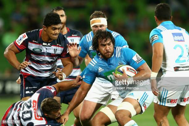 Steven Luatua of the Blues is tackled during the round one Super Rugby match between the Melbourne Rebels and the Auckland Blues at AAMI Park on...
