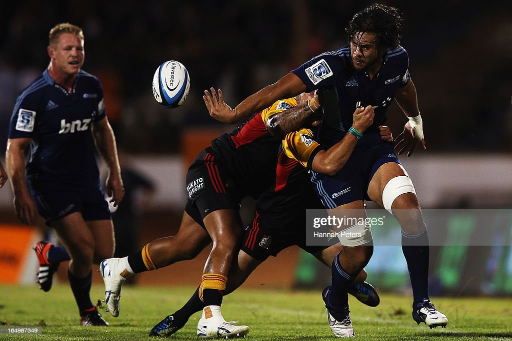 Steven Luatua of the Blues offloads the ball during the round seven Super Rugby match between the Chiefs and the Blues at Bay Park on March 30 2013...