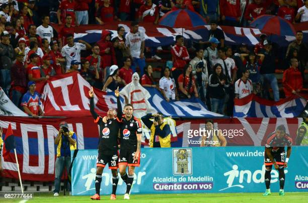 Steven Lucumi of America de Cali celebrates with teammate Luis Carlos Arias after scoring the first goal of his team during a match between...