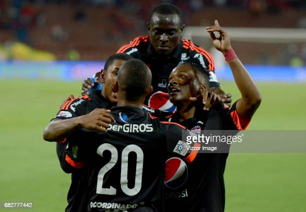Steven Lucumi of America de Cali celebrates with teammates after scoring the first goal of his team during a match between Independiente Medellin and...