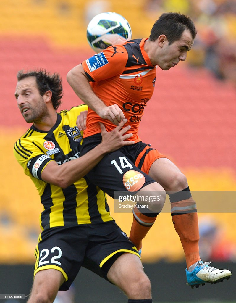 Steven Lustica of the Roar and Andrew Durante of the Phoenix challenge for the ball during the round 21 A-League match between the Brisbane Roar and the Wellington Phoenix at Suncorp Stadium on February 17, 2013 in Brisbane, Australia.