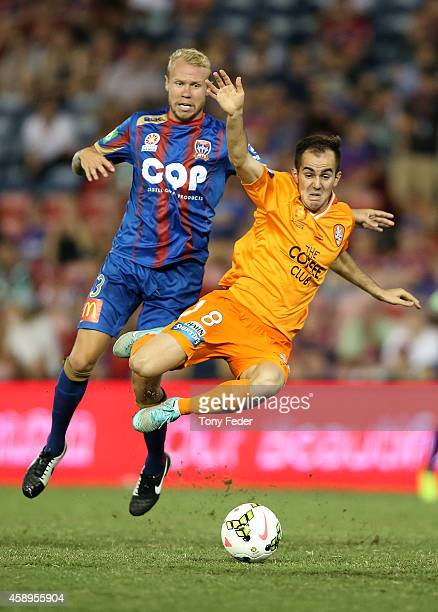 Steven Lustica of the Roar contests the ball with Taylor Regan of the Jets during the round six ALeague match between the Newcastle Jets and Brisbane...