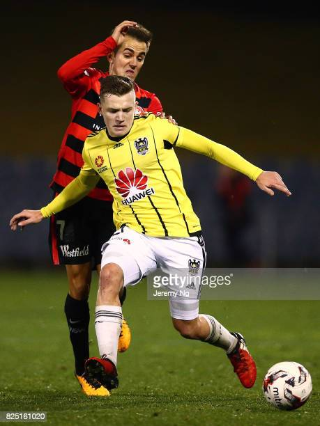 Steven Lustica of the Wanderers and Scott Galloway of the Phoenix challenge for the ball during the FFA Cup round of 32 match between the Western...
