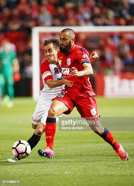 Steven Lustica of the Wanderers competes for the ball with Tarek Elrich of Adelaide United during the round two ALeague match between Adelaide United...
