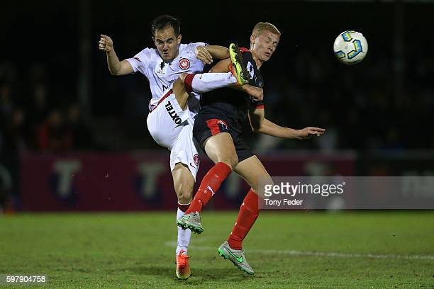 Steven Lustica of the Wanderers contests the ball with Dylan Holz of Edgeworth during the FFA Cup ROUnd of 16 match between Edgeworth FC and the...