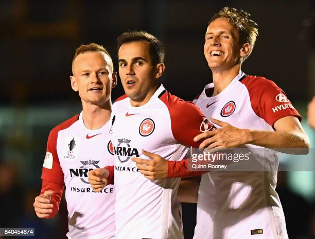 Steven Lustica of the Wanderers is congratulated by team mates after scoring a goalduring the round of 16 FFA Cup match between Bentleigh Greens and...
