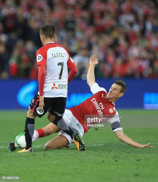 Steven Lustica of the Wanderers is tackled by Laurent Koscielny of Arsenal during the match between the Western Sydney Wanderers and Arsenal FC at...