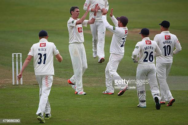 Steven Magoffin of Sussex celebrates with captain Ed Joyce after claiming the wicket of Marcus Trescothick during day two of the LV County...
