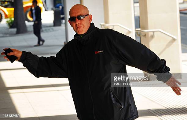 Steven Malcolm arrives at Manchester Crown Court in Manchester northwest England on July 4 2011 Three people have appeared in court today accused of...