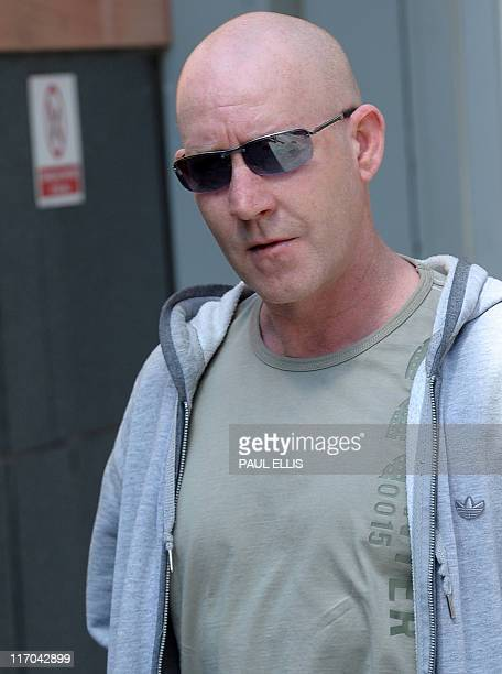 Steven Malcolm arrives at Manchester Magistrates Court in Manchester northwest England on June 20 2011 Three people have appeared in court today...