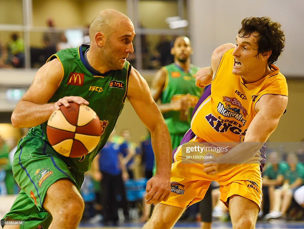 Steven Markovic of the Crocodiles drives to the basket past Ben Madgen of the Kings during the round 15 NBL match between the Townsville Crocodiles and Sydney Kings at Townsville RSL Stadium on January 16, 2015 in Townsville, Australia.