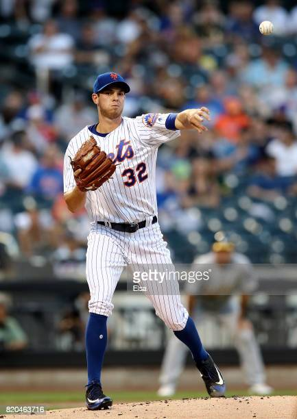 Steven Matz of the New York Mets tries to pick off Rajai Davis of the Oakland Athletics at first base in the first inning on July 21 2017 at Citi...