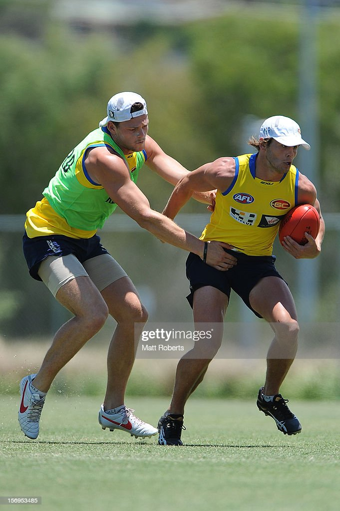 Steven May attempts to tackle Maverick Weller (R) during a Gold Coast Suns pre-season AFL training session at Metricon Stadium on November 26, 2012 on the Gold Coast, Australia.
