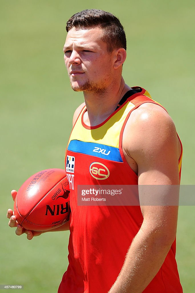 Steven May looks on during a Gold Coast Suns AFL pre-season training session at Metricon Stadium on December 18, 2013 on the Gold Coast, Australia.