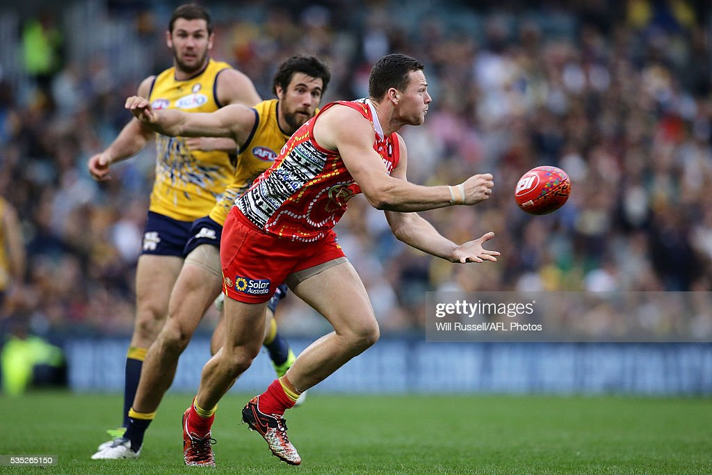 Steven May of the Suns handballs during the round 10 AFL match between the West Coast Eagles and the Gold Coast Suns at Domain Stadium on May 29, 2016 in Perth, Australia.