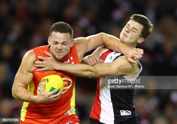 Steven May of the Suns is tackled during the round 14 AFL match between the St Kilda Saints and the Gold Coast Suns at Etihad Stadium on June 25 2017...