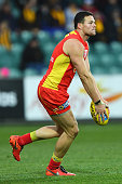 Steven May of the Suns kicks during the round 14 AFL match between the Hawthorn Hawks and the Gold Coast Suns at Aurora Stadium on June 26 2016 in...