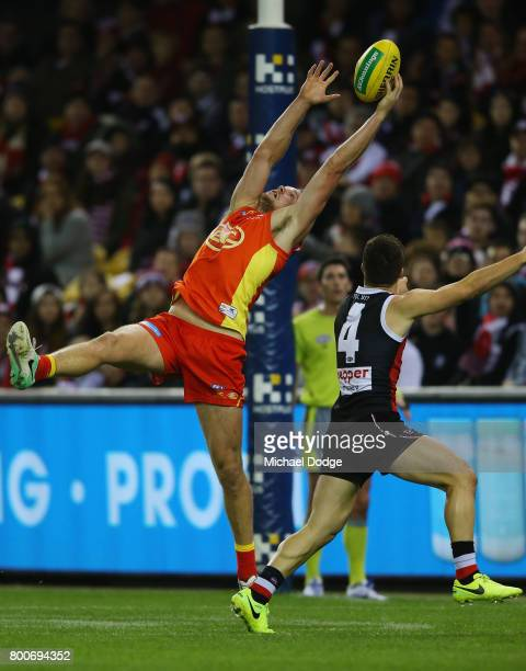 Steven May of the Suns marks the ball against Jade Gresham of the Saints during the round 14 AFL match between the St Kilda Saints and the Gold Coast...