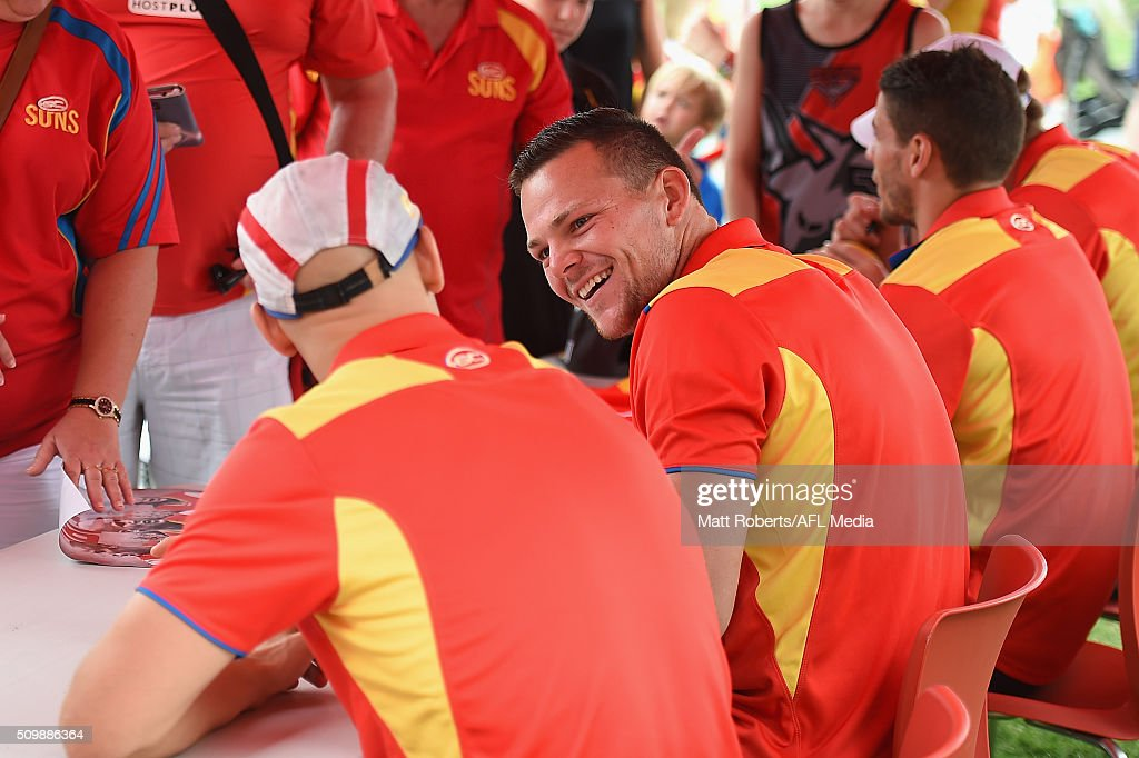 Steven May shares a laugh with Gary Ablett as he signs autographs for fans during the Gold Coast Suns AFL open day at Metricon Stadium on February 13, 2016 on the Gold Coast, Australia.