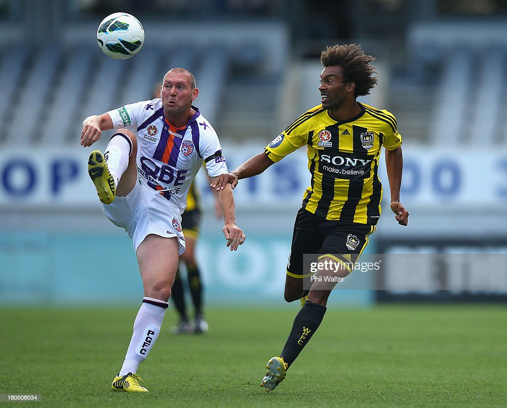 Steven McGarry of Perth (L) clears the ball from Isaka Cernak of Wellington during the round 19 A-League match between the Wellington Phoenix and the Perth Glory at Eden Park on February 2, 2013 in Auckland, New Zealand.