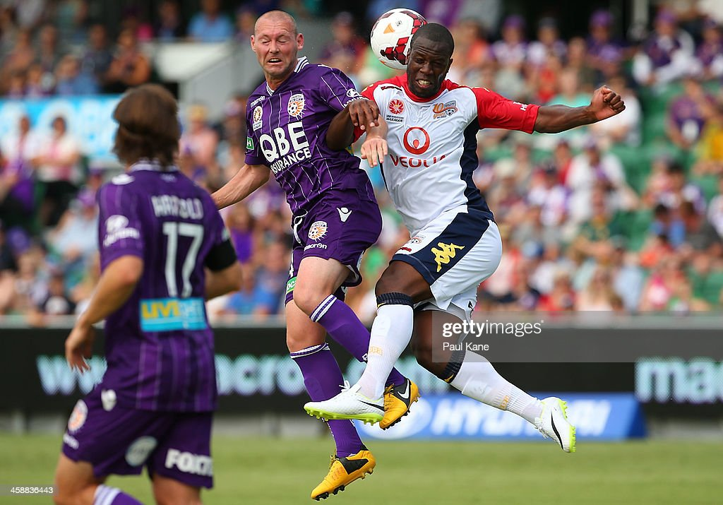 Steven McGarry of the Glory and <a gi-track='captionPersonalityLinkClicked' href=/galleries/search?phrase=Bruce+Djite&family=editorial&specificpeople=775797 ng-click='$event.stopPropagation()'>Bruce Djite</a> of Adelaide contest for the ball during the round 11 A-League match between Perth Glory and Adelaide United at nib Stadium on December 22, 2013 in Perth, Australia.