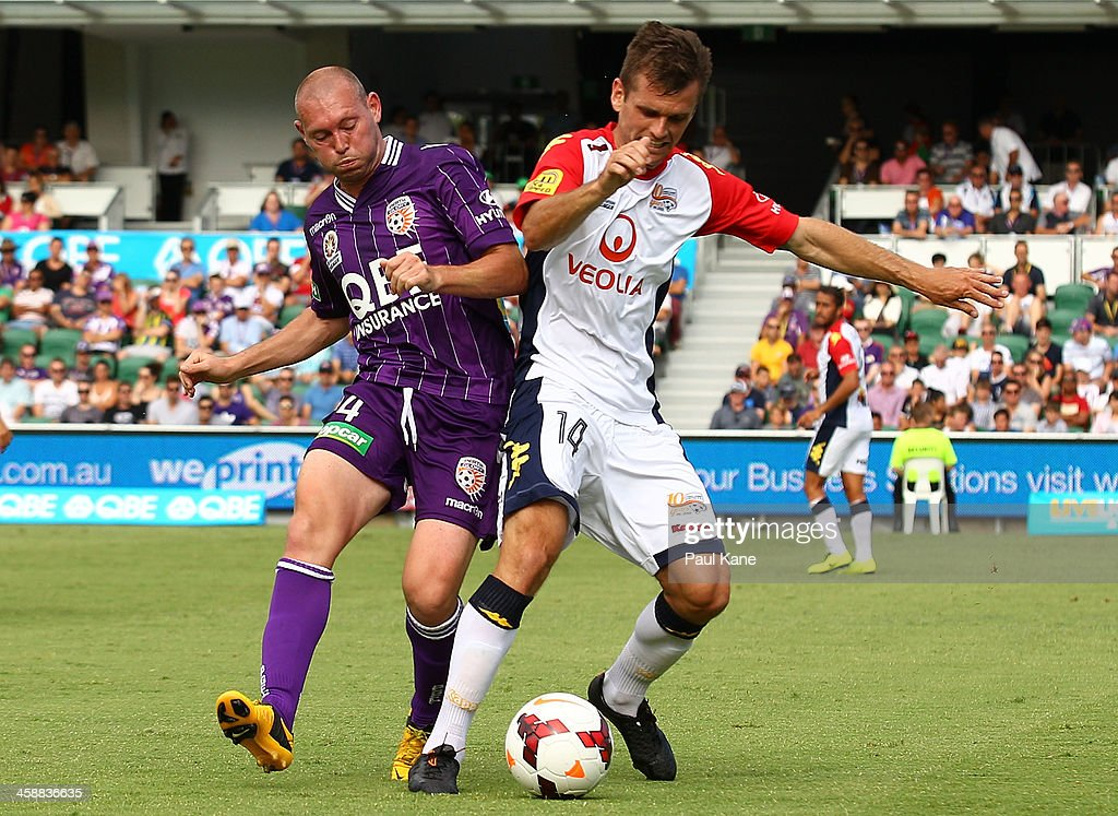 Steven McGarry of the Glory and Cameron Watson of Adelaide contest for the ball during the round 11 A-League match between Perth Glory and Adelaide United at nib Stadium on December 22, 2013 in Perth, Australia.