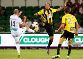 Steven McGarry of the Glory and Leo Bertos of the Phoenix contest for the ball during the round nine ALeague match between Perth Glory and the...