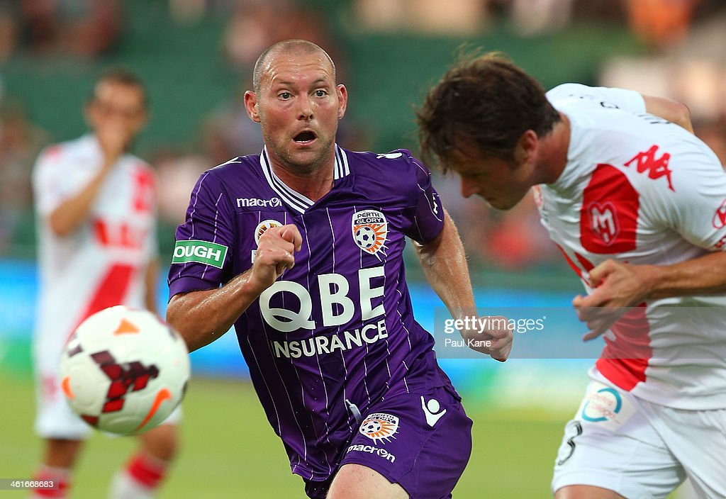 Steven McGarry of the Glory looks as Robbie Wielaert of the Heart heads the ball during the round 14 A-League match between Perth Glory and the Melbourne Heart at nib Stadium on January 10, 2014 in Perth, Australia.