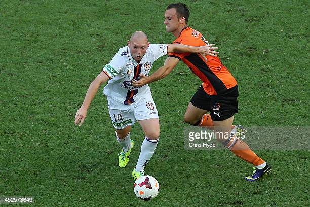Steven McGary of the Glory and Ivan Franjic of the Roar compete for the ball during the round eight ALeague match between Brisbane Roar and Perth...