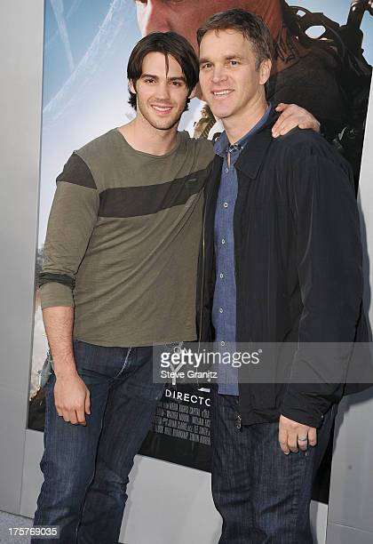 Steven McQueen and Luc Robitaille arrives at the 'Elysium' Los Angeles Premiere at Regency Village Theatre on August 7 2013 in Westwood California