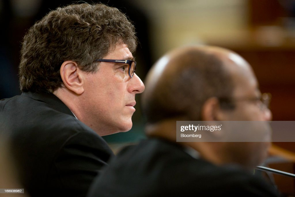 Steven Miller, who was forced out as acting commissioner of the Internal Revenue Service (IRS), left, and J. Russell George, U.S. Treasury inspector general for tax administration, listen during a House Ways and Means Committee hearing in Washington, D.C., U.S., on Friday, May 17, 2013. The scandal at the IRS is the 'latest example of a culture of cover-ups' at the agency and in the Obama administration, Representative Dave Camp, chairman of the House Ways and Means Committee, said. Photographer: Andrew Harrer/Bloomberg via Getty Images