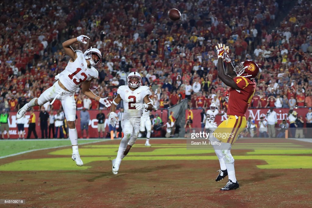 Steven Mitchell Jr. #4 of the USC Trojans makes a reception to score a fourth quarter touchdown against the Stanford Cardinal at Los Angeles Memorial Coliseum on September 9, 2017 in Los Angeles, California.