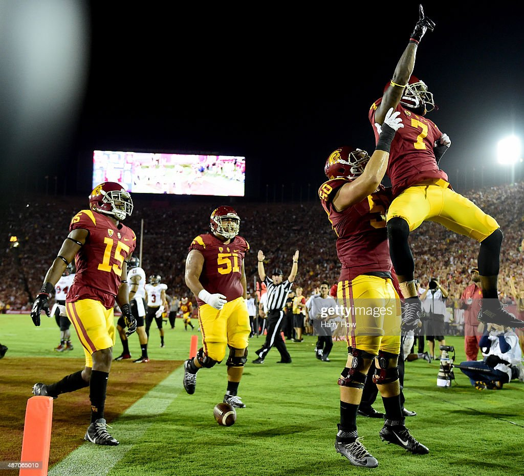 Steven Mitchell #7 of the USC Trojans celebrates his touchdown as he is lifted by Viane Talamaivao #60 to take a 14-0 lead over the Arkansas State Red Wolves during the second quarter at Los Angeles Coliseum on September 5, 2015 in Los Angeles, California.