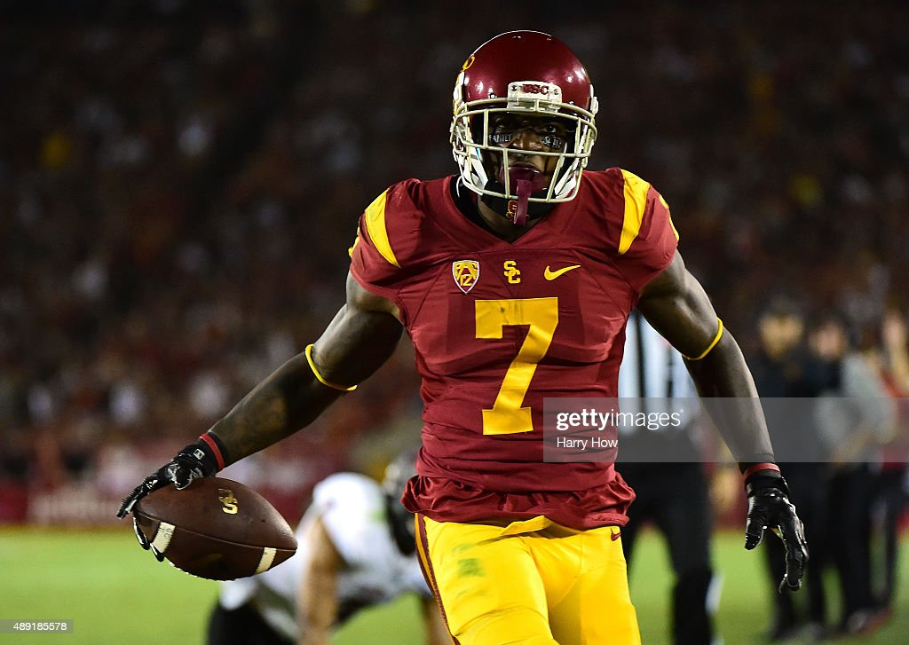 Steven Mitchell #7 of the USC Trojans reacts as he scores a touchdown for a 14-0 lead over Arkansas State Red Wolves during the first quarter at Los Angeles Coliseum on September 5, 2015 in Los Angeles, California.