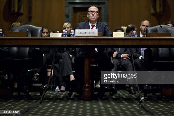 Steven Mnuchin Treasury secretary nominee for US Presidentelect Donald Trump listens during a Senate Finance Committee confirmation hearing in...