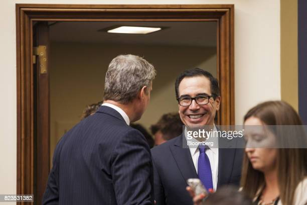 Steven Mnuchin US Treasury secretary center smiles while arriving for a House Financial Services hearing on Capitol Hill in Washington DC US on...