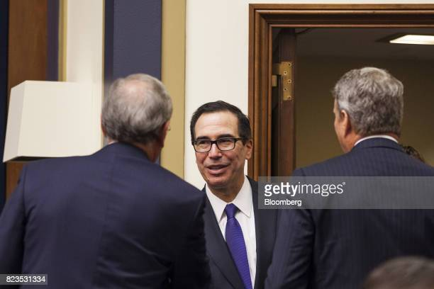 Steven Mnuchin US Treasury secretary center speaks to attendees while arriving for a House Financial Services hearing on Capitol Hill in Washington...