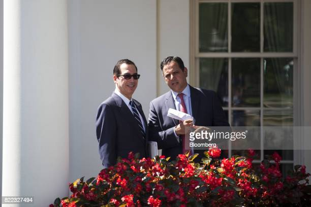 Steven Mnuchin US Treasury secretary left and Tony Sayegh spokesman for the US Treasury Department stand outside the West Wing of the White House in...