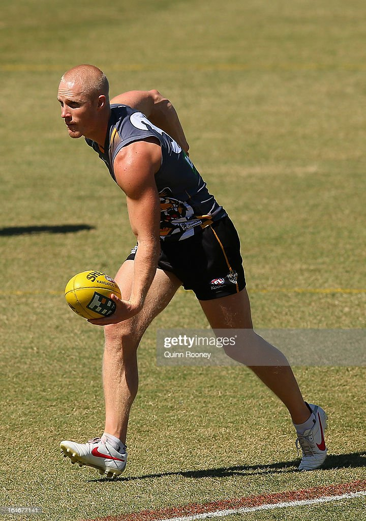 Steven Morris of the Tigers handballs during a Richmond Tigers AFL training session at ME Bank Centre on March 26, 2013 in Melbourne, Australia.
