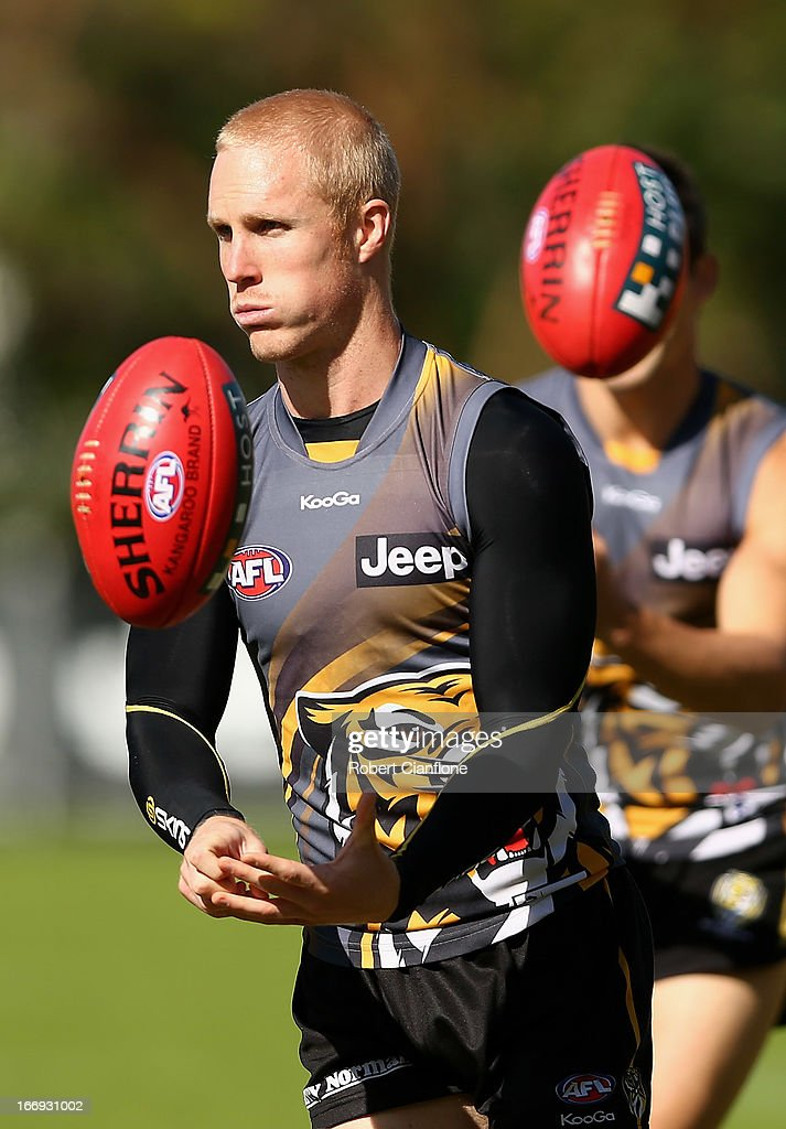Steven Morris of the Tigers handballs during a Richmond Tigers AFL training session at ME Bank Centre on April 19, 2013 in Melbourne, Australia.