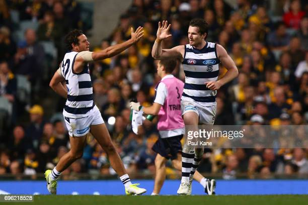 Steven Motlop and Patrick Dangerfield of the Cats celebrate a goal during the round 13 AFL match between the West Coast Eagles and the Geelong Cats...