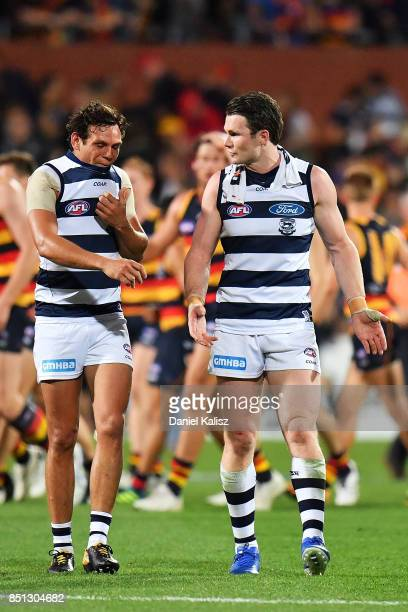 Steven Motlop and Patrick Dangerfield of the Cats walk from the field at half time during the First AFL Preliminary Final match between the Adelaide...