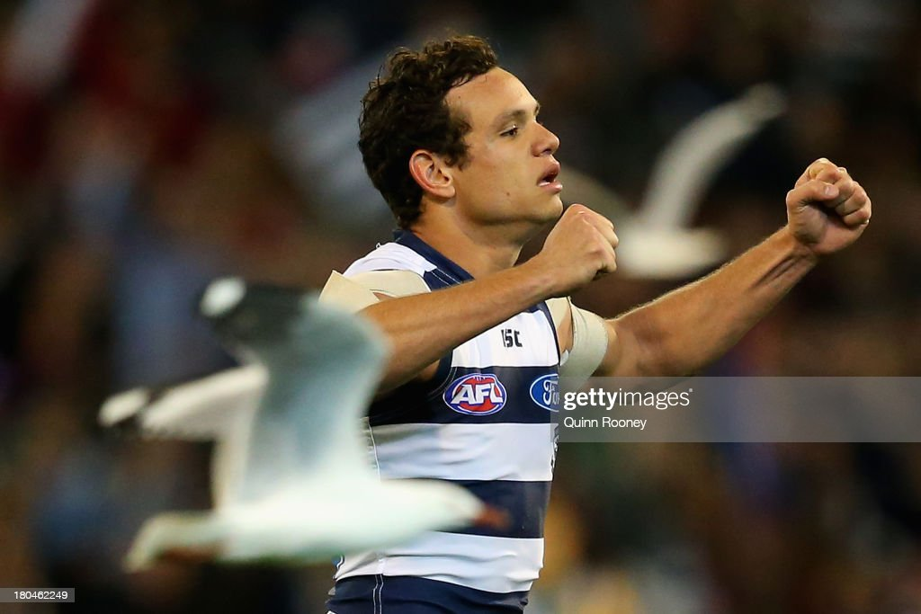 Steven Motlop of the Cats celebrates winning the Second Semi Final match between the Geelong Cats and the Port Adelaide Power at Melbourne Cricket Ground on September 13, 2013 in Melbourne, Australia.
